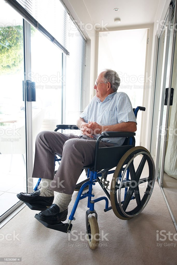 Handicapped senior patient sitting on a wheelchair royalty-free stock photo