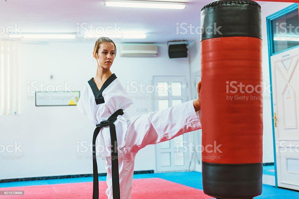 Handicapped taekwondo girl kicking back kick stock photo