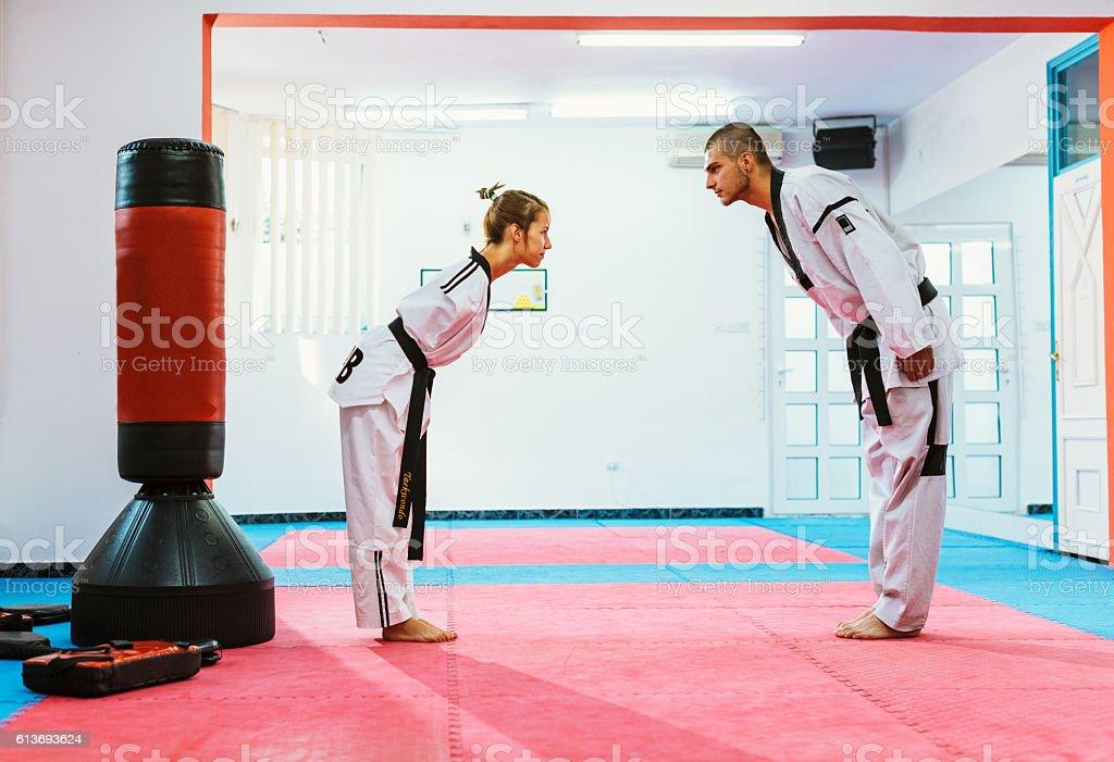 Handicapped taekwondo girl takes a bow stock photo