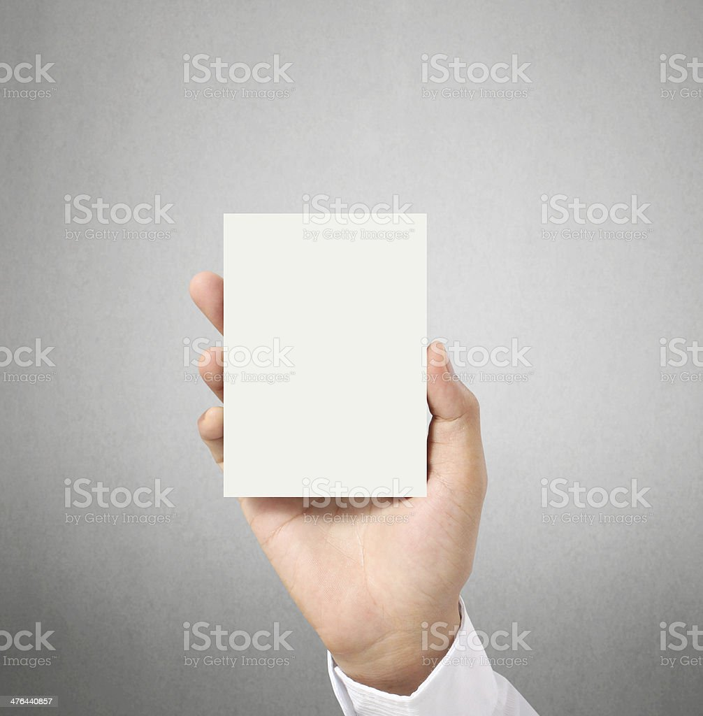 handing a blank business acard  in hand stock photo