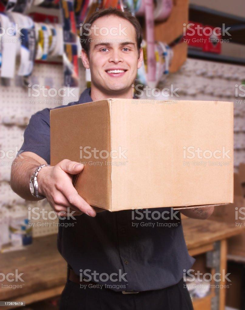Handing a Box royalty-free stock photo