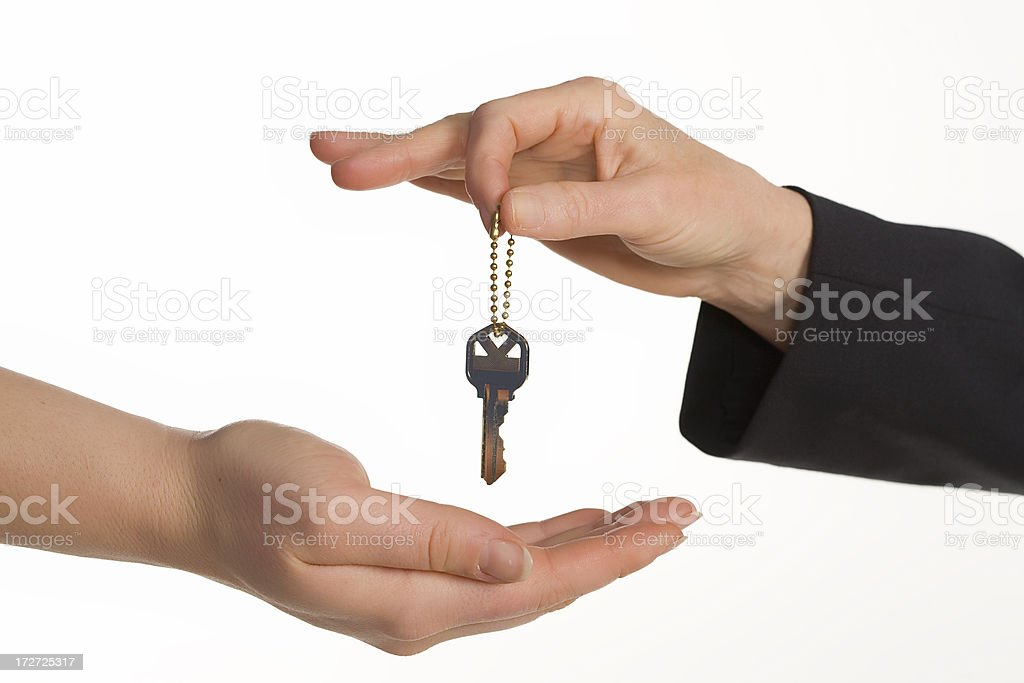 handing a key over royalty-free stock photo