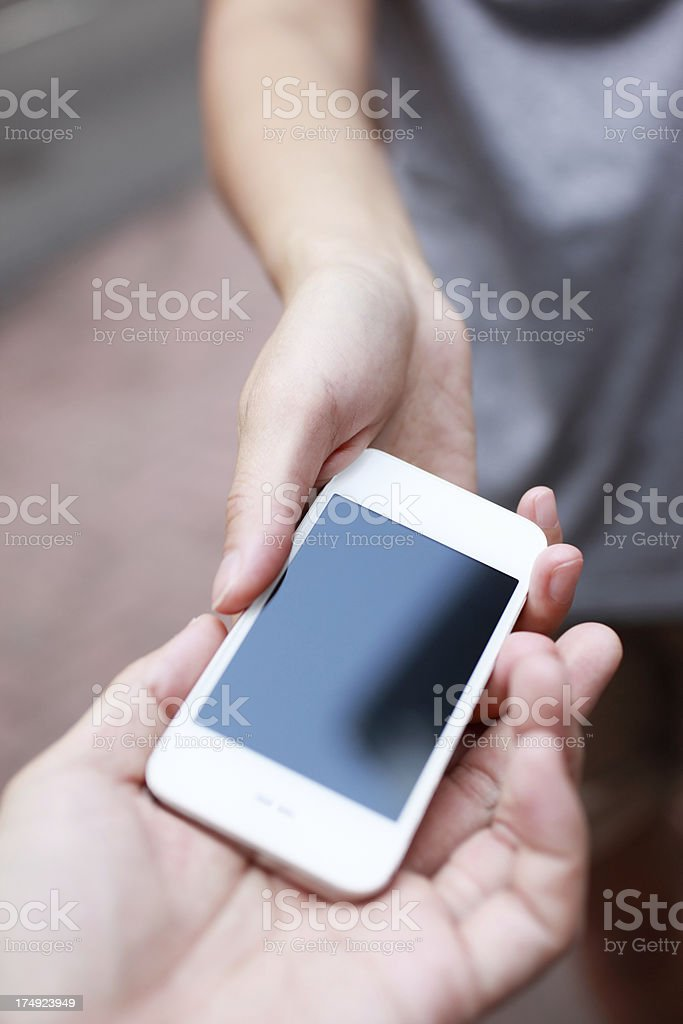 Handing a Smart Phone royalty-free stock photo