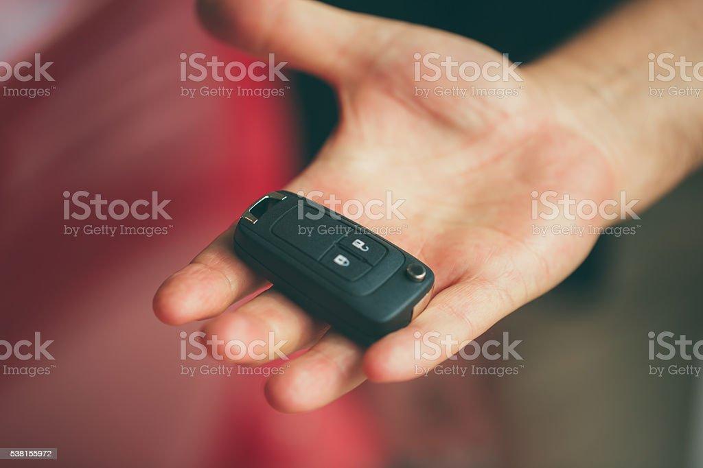Handing car keys stock photo