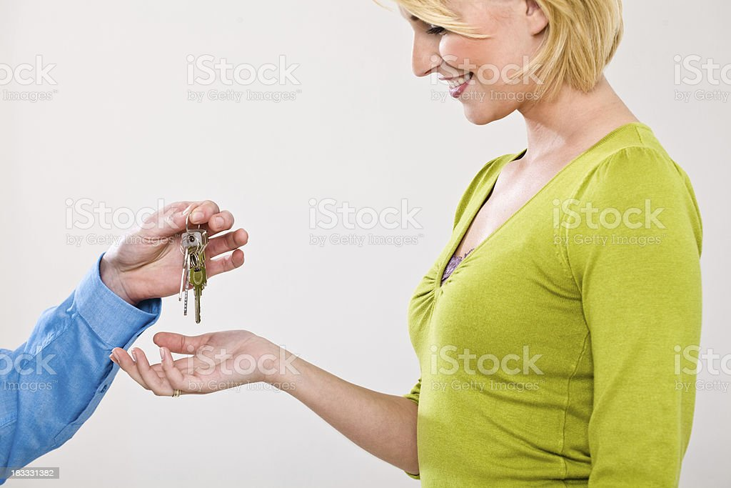 Handing keys royalty-free stock photo