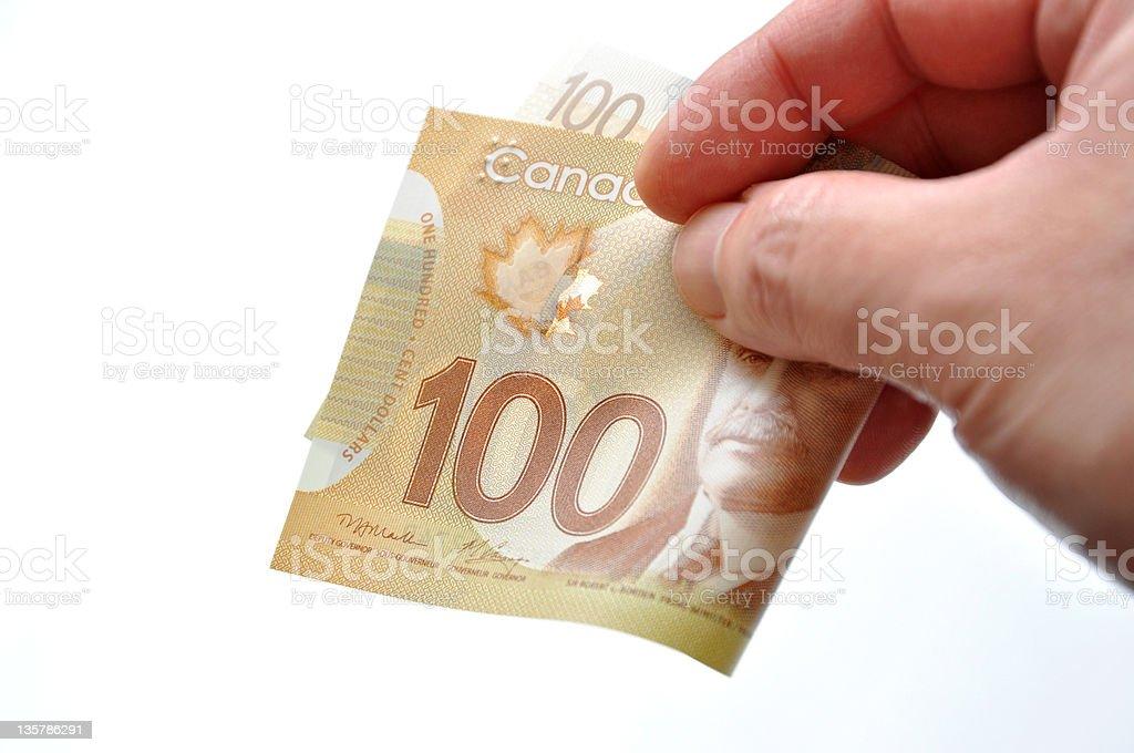 Handing one hundred bill royalty-free stock photo