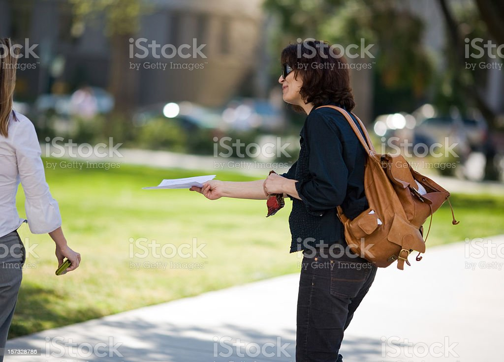 Handing Out Fliers royalty-free stock photo