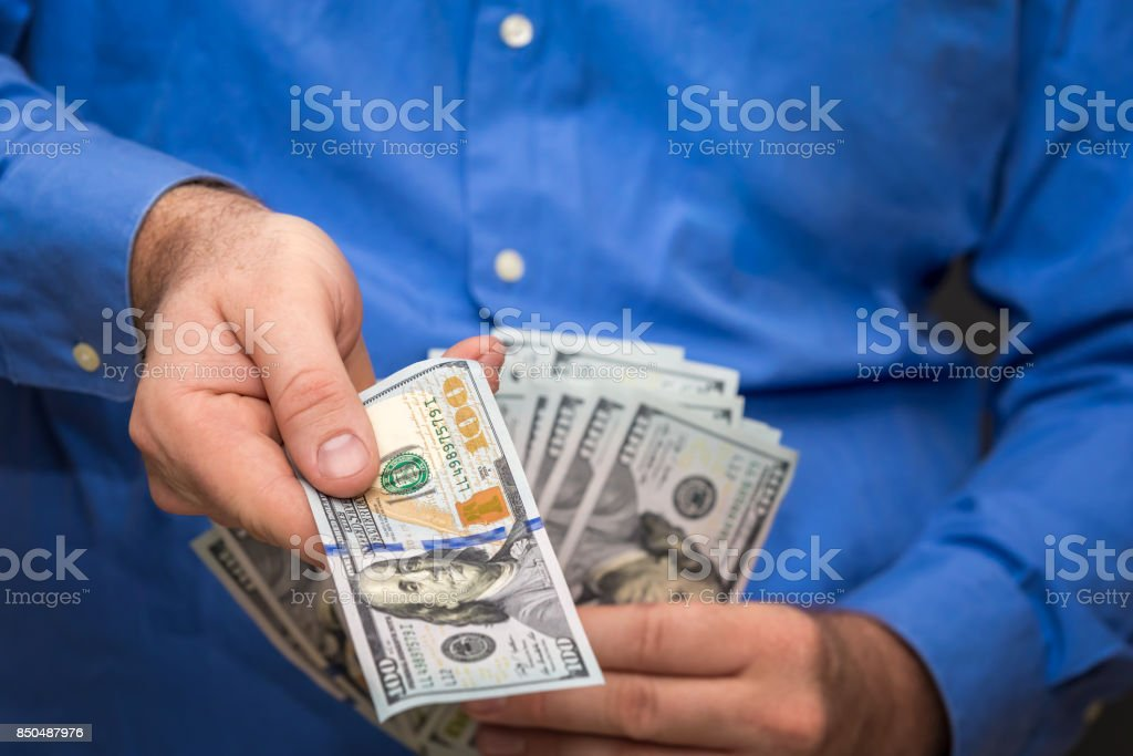 Handing Over a Hundred stock photo