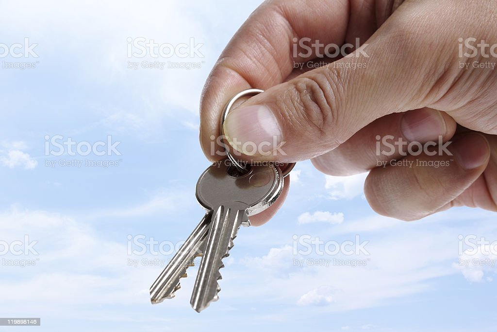 Handing over house keys royalty-free stock photo