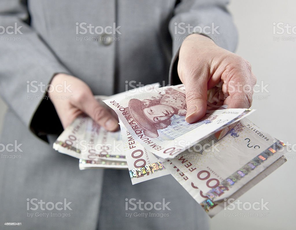 Handing over money stock photo