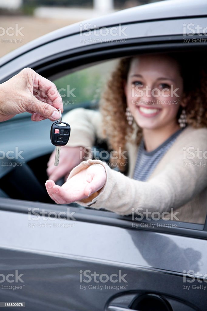 Handing over the car key stock photo