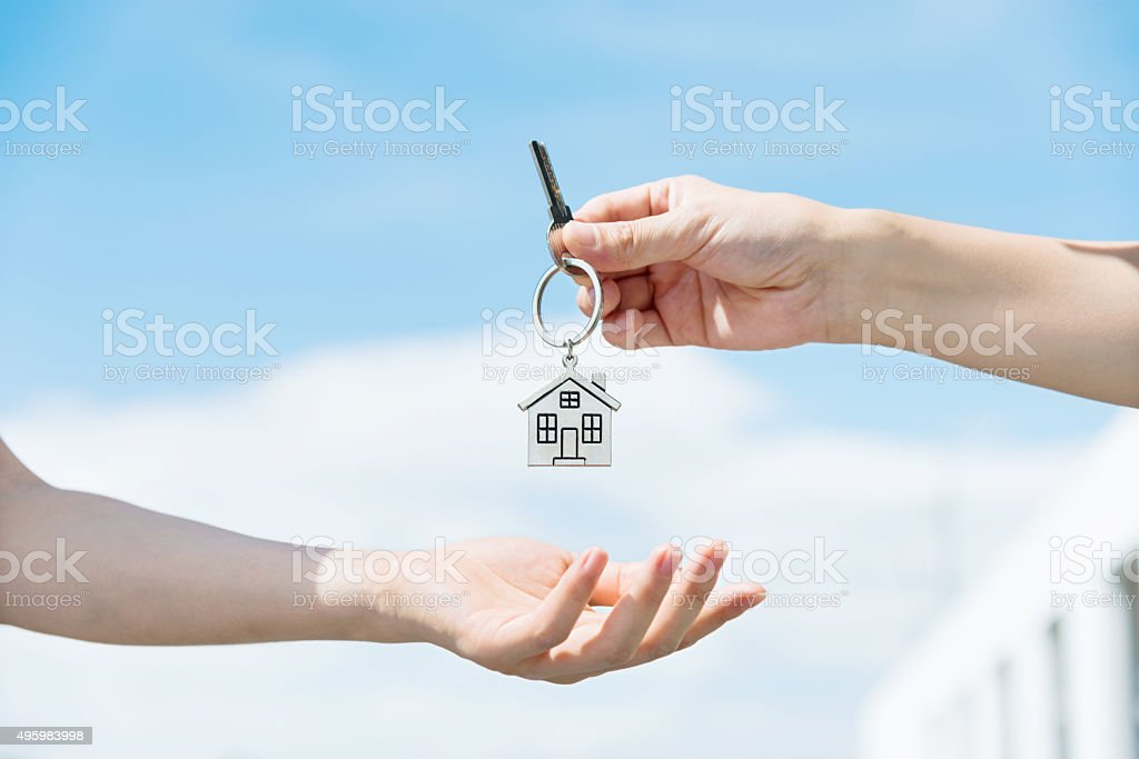 Handing over the house keys stock photo