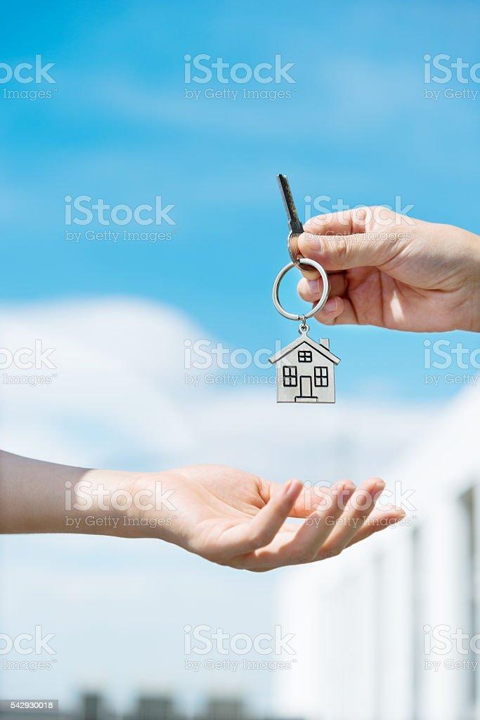 Handing over the house keys stock photo