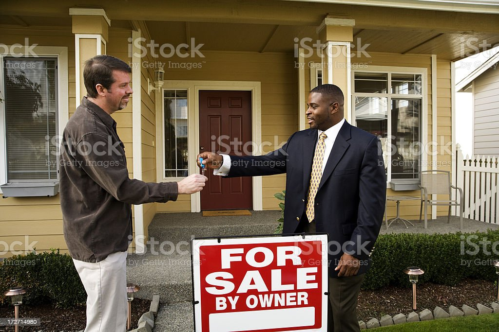 Handing over the keys royalty-free stock photo