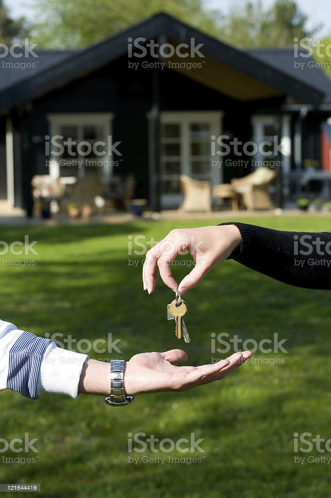 Handing over the keys to a new home or house royalty-free stock photo