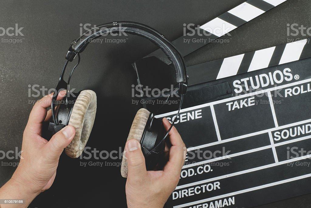 Handle headphone on a slate black background stock photo