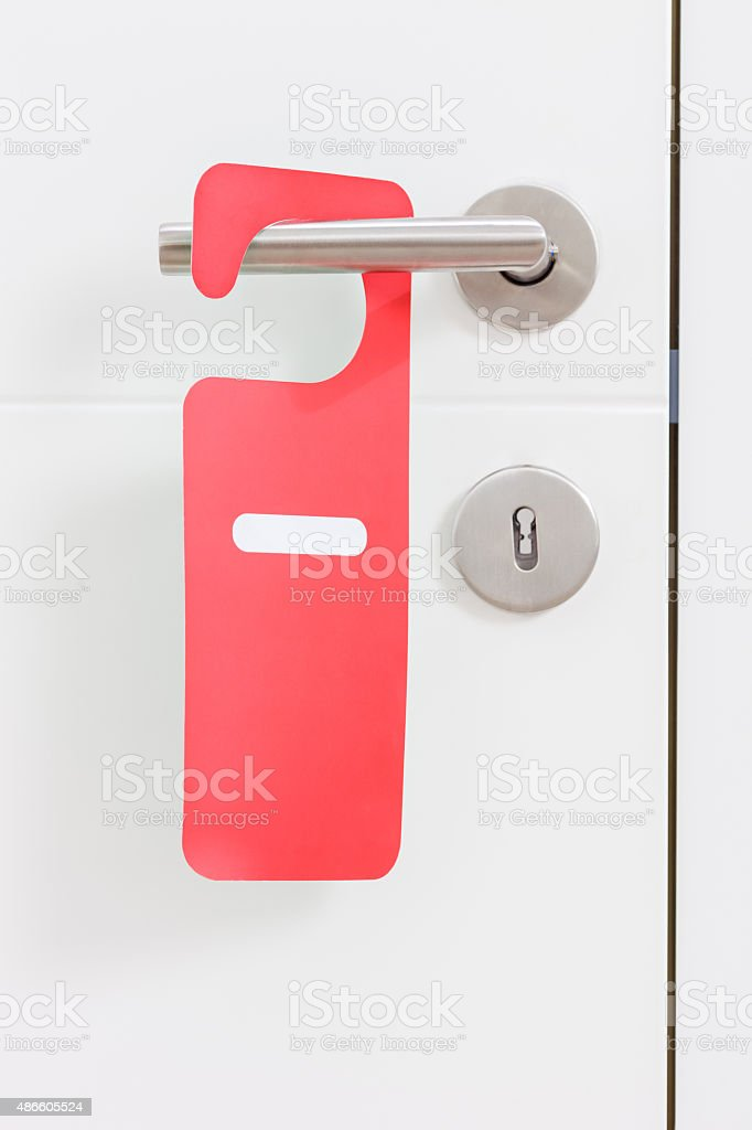 Handle of door with do not disturb label on it stock photo