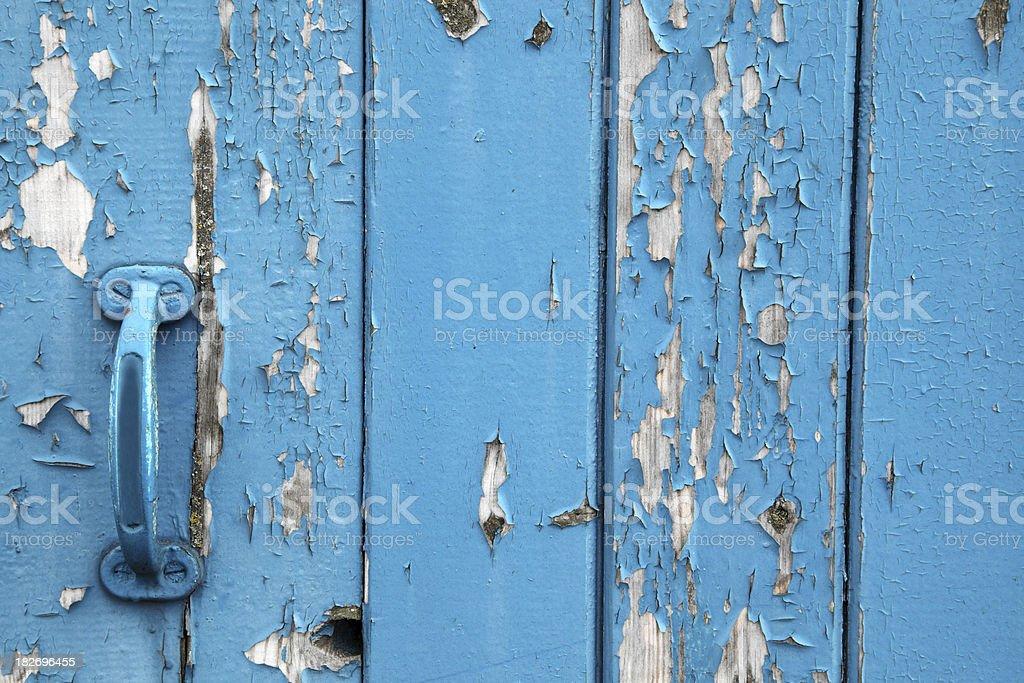 handle on old blue wooden door royalty-free stock photo