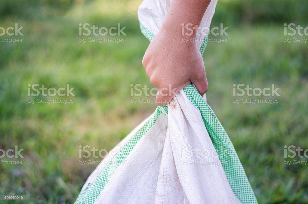 Handle Sacks of rice, fertilizer farmer stock photo