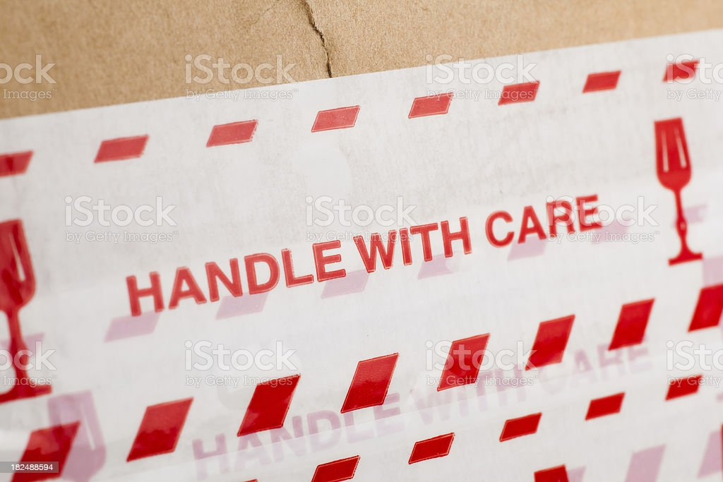 Cardboard box with message \'Handle with care\'.