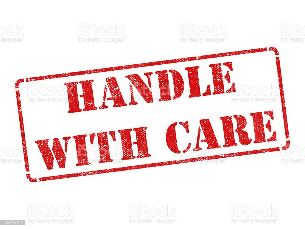 Handle with Care -  Red Rubber Stamp. stock photo
