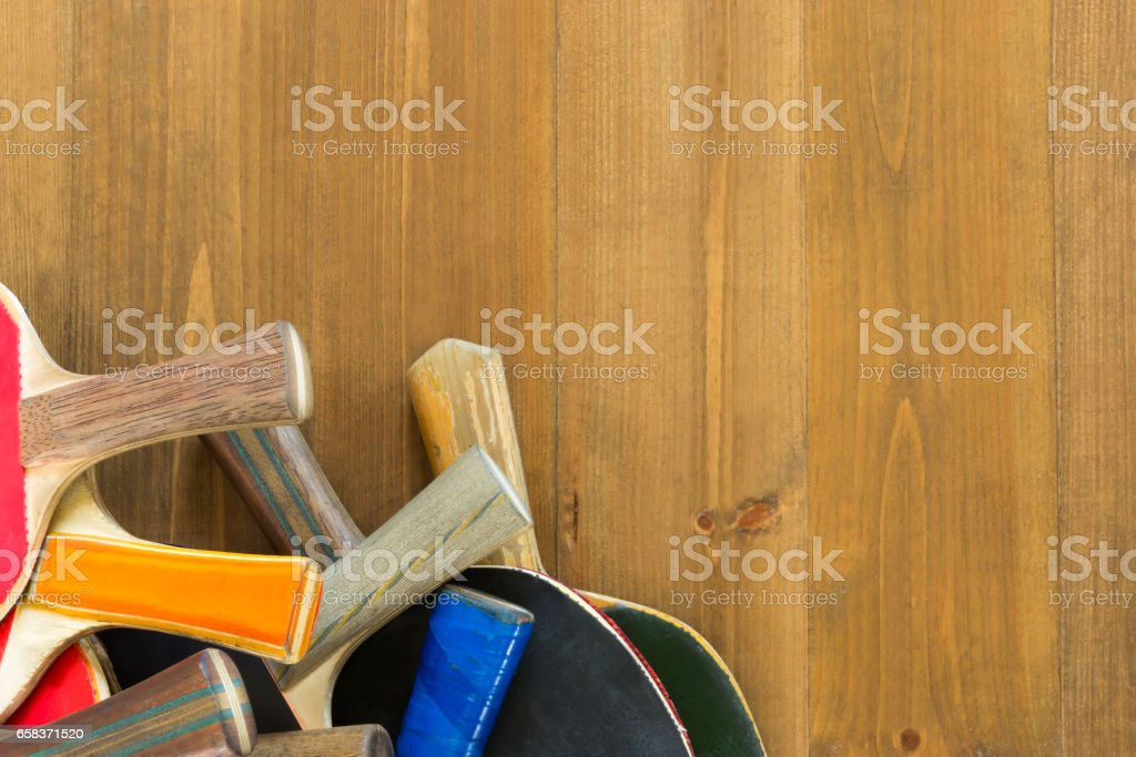 Handles from old ping pong rackets on a beautiful board stock photo