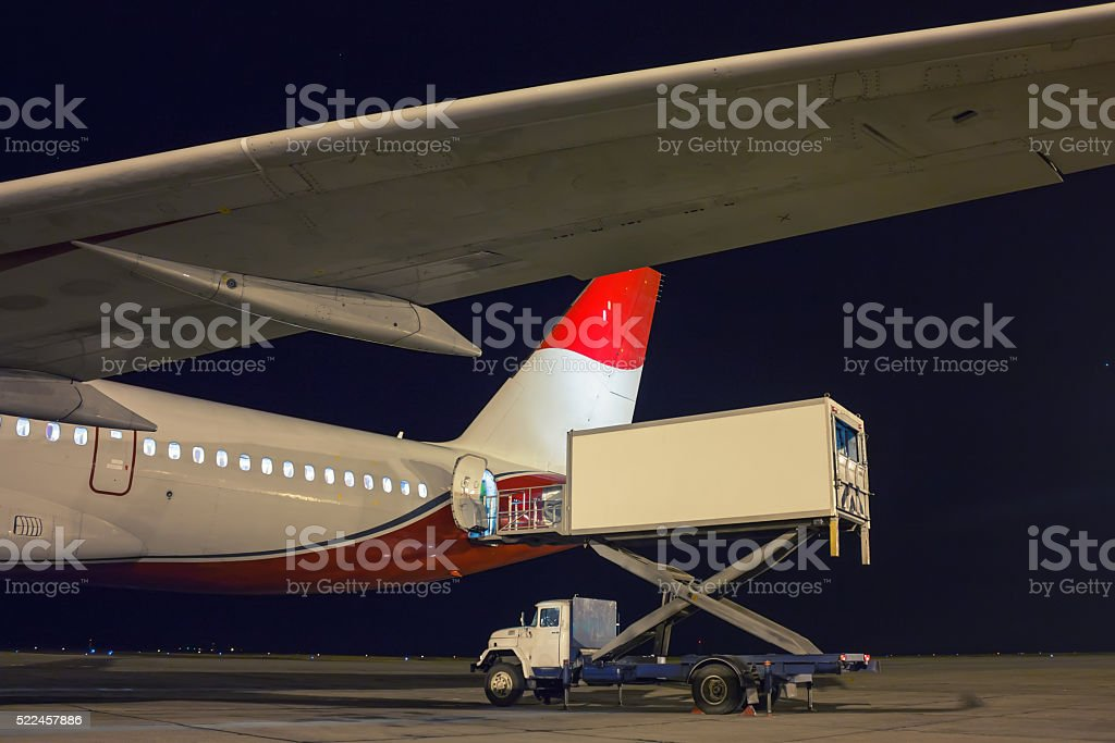 Handling food on the plane at night royalty-free stock photo
