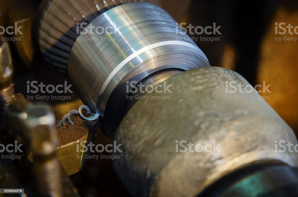 Handling on lathe, outer groove with fixing parts in centers stock photo