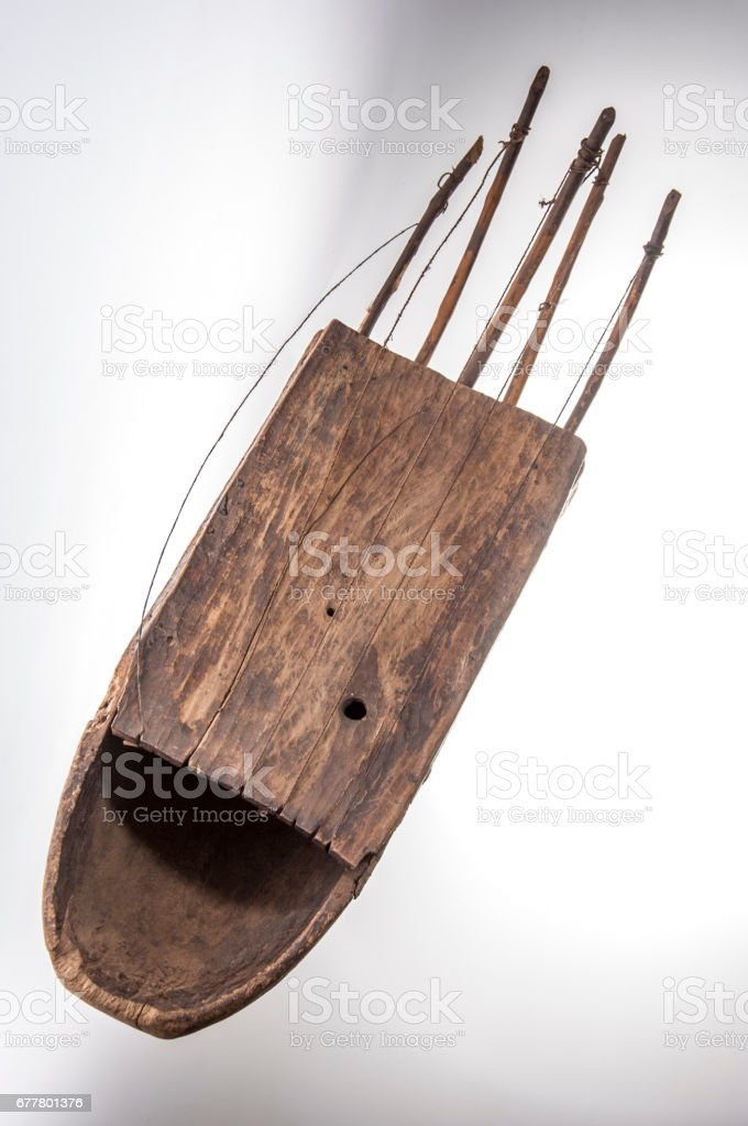 Handmade african instrument, guitar species isolated on white background stock photo