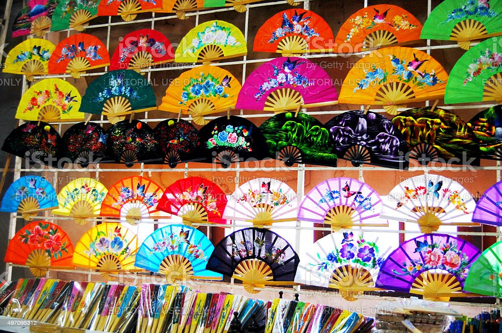 Handmade Art Umbrella and fan for show and sale traveler stock photo