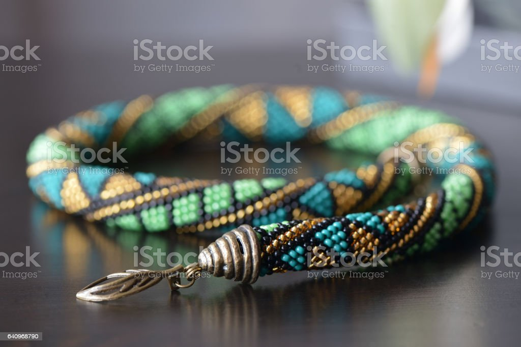Handmade beaded crochet necklace with geometrical pattern stock photo
