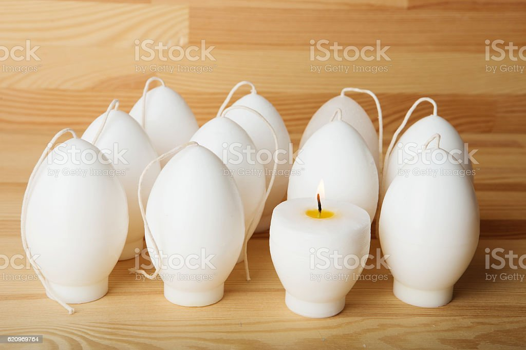 Handmade candles in the shape of eggs ready for paint stock photo