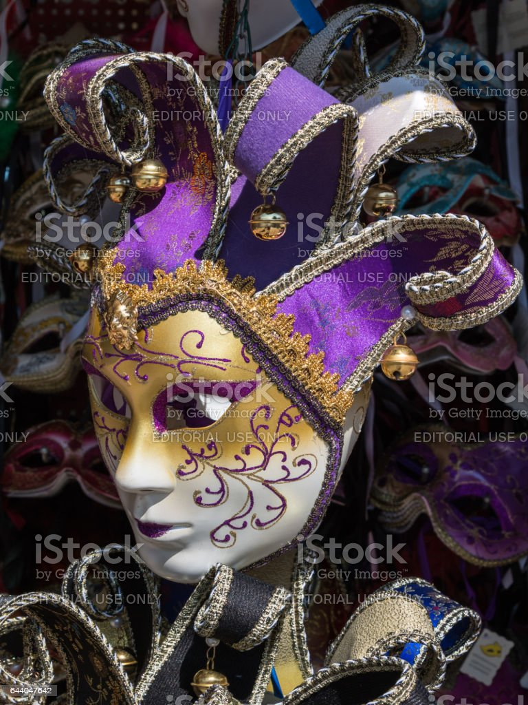 Venice, Italy - june 2015: Handmade Carnival Venetian Mask in Gold and Pink stock photo