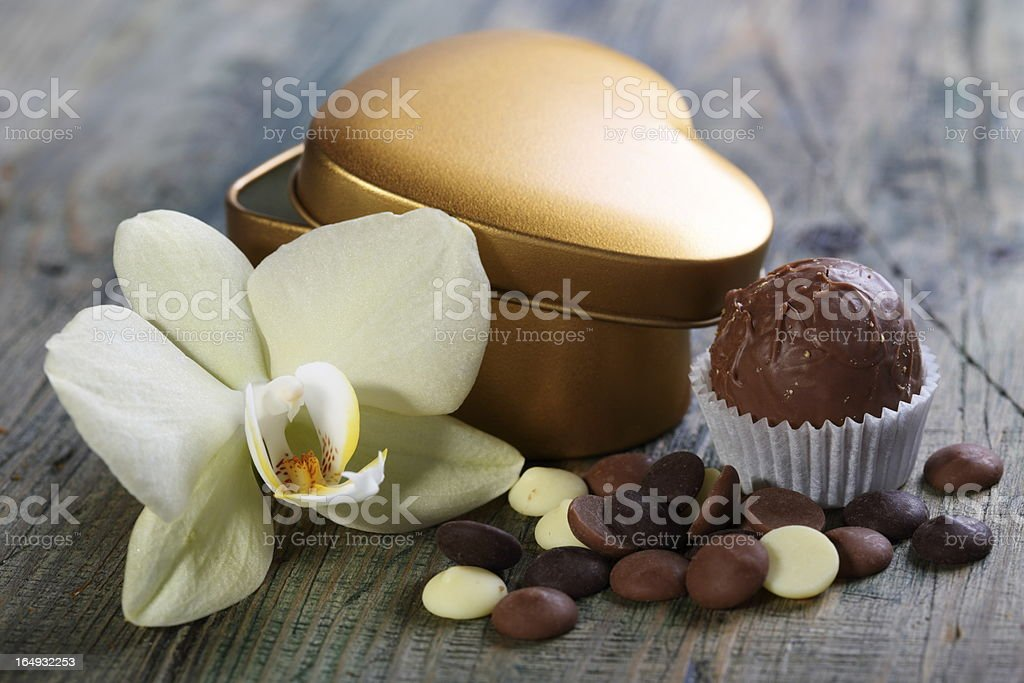 Handmade chocolates and flowers. royalty-free stock photo