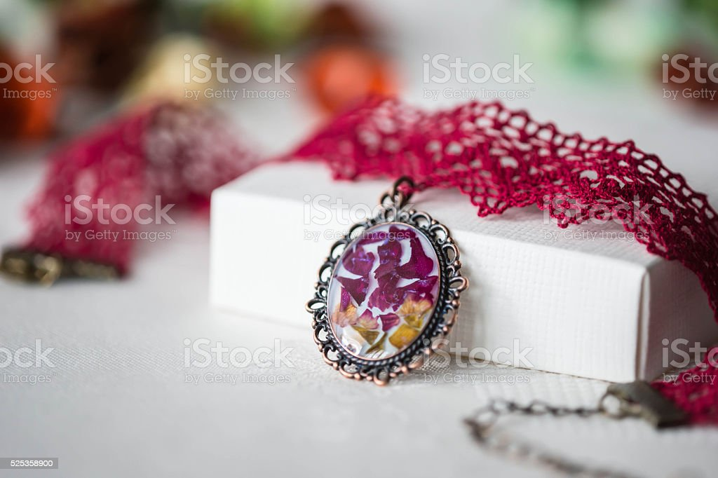 Handmade choker necklace from lace and pendant with natural flowers stock photo