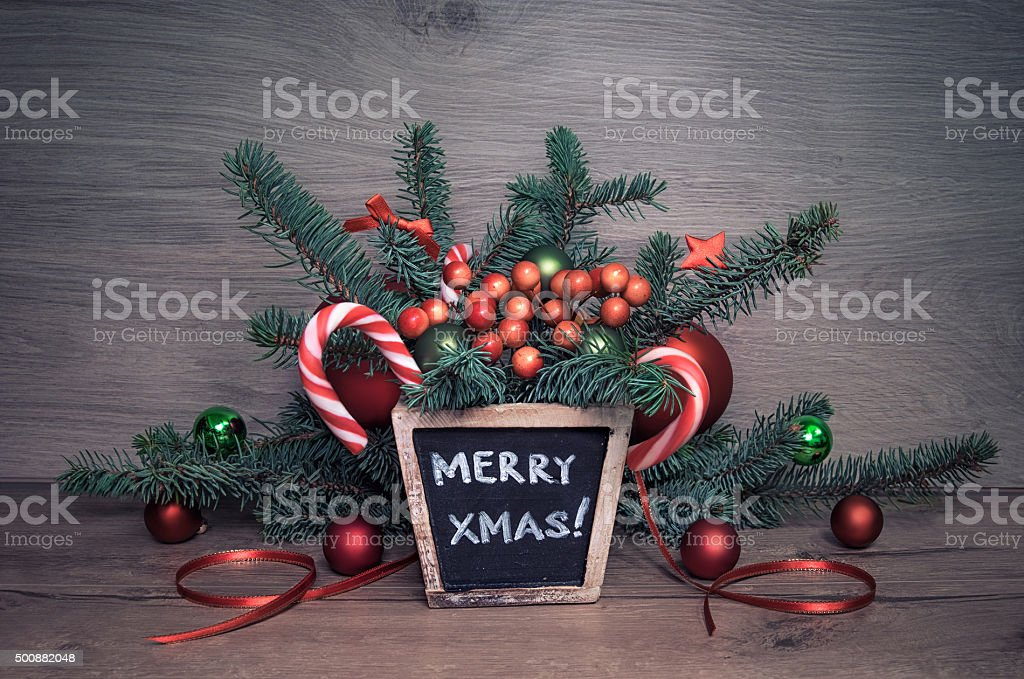 Handmade Christmas arrangement and chalk message 'Merry Christma stock photo