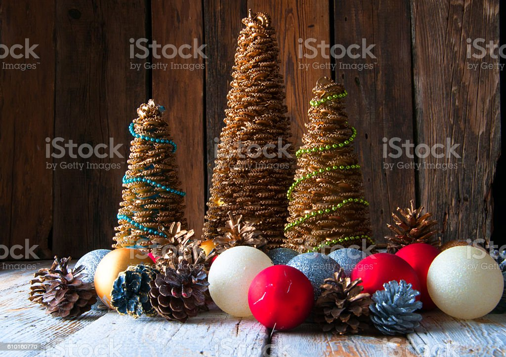 Handmade Christmas trees with cones and christmas decorations stock photo