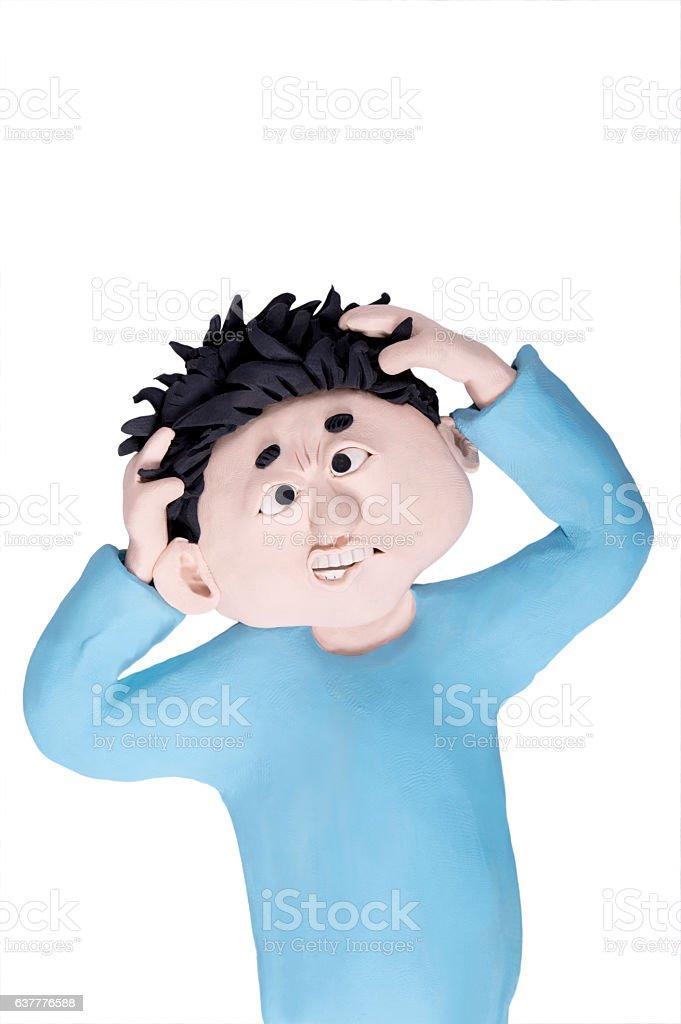 handmade clay figurine: furious boy stock photo