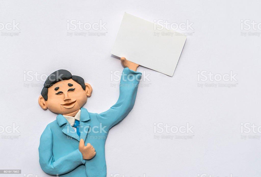 handmade clay illustration, man holding white paper stock photo