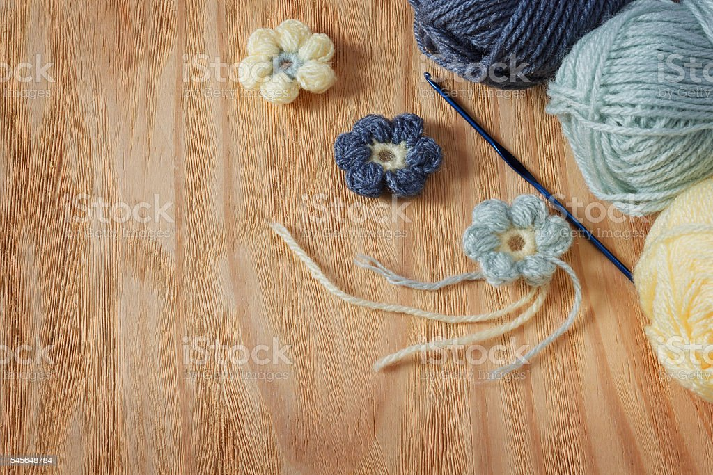 Handmade colorful crochet flower with skein stock photo