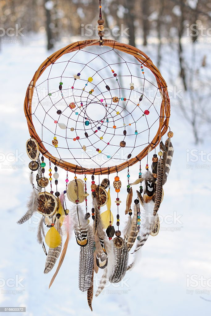 Handmade colorfull dream catcher in the snowy forest stock photo