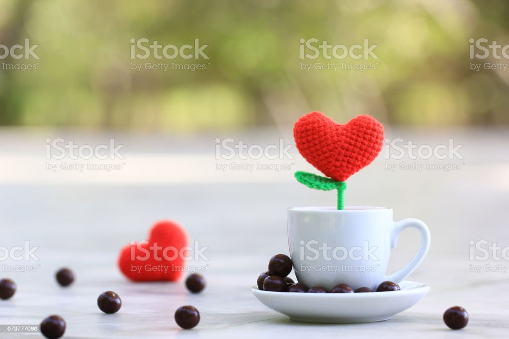 Handmade crochet heart in the white cup for valentines day stock photo