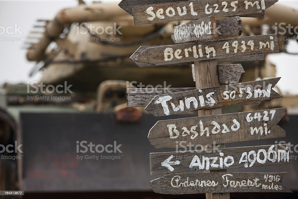 Hand-made directions sign on an army base. royalty-free stock photo