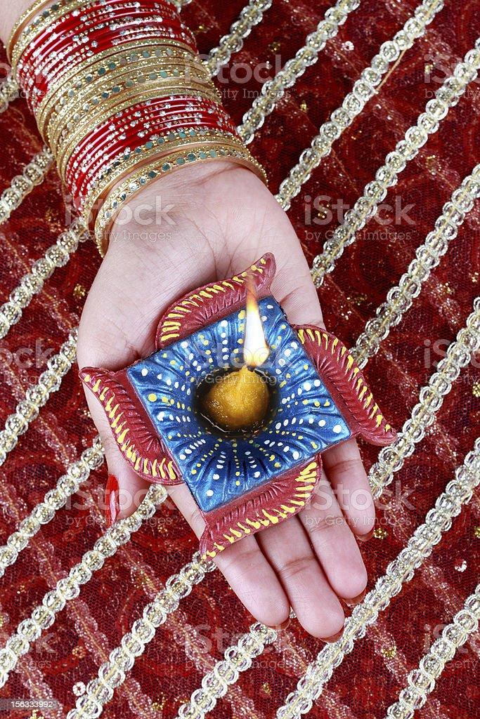 Handmade Diwali Diya Lamp in Hand royalty-free stock photo