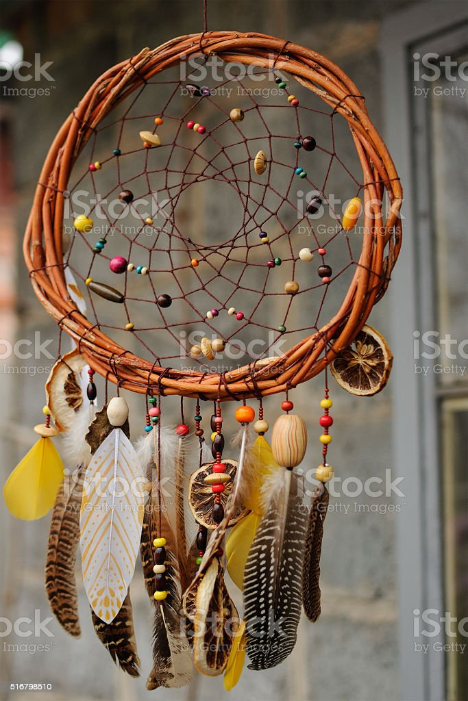 Handmade dream catcher at wall in background stock photo