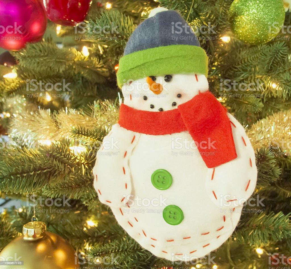 Handmade felt snowman hanging on Christmas tree royalty-free stock photo
