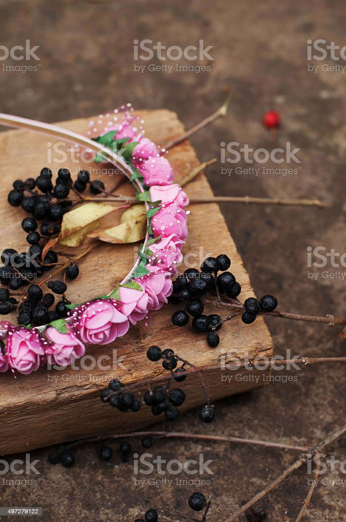Handmade flowers wreath on outdoor metal stand. royalty-free stock photo