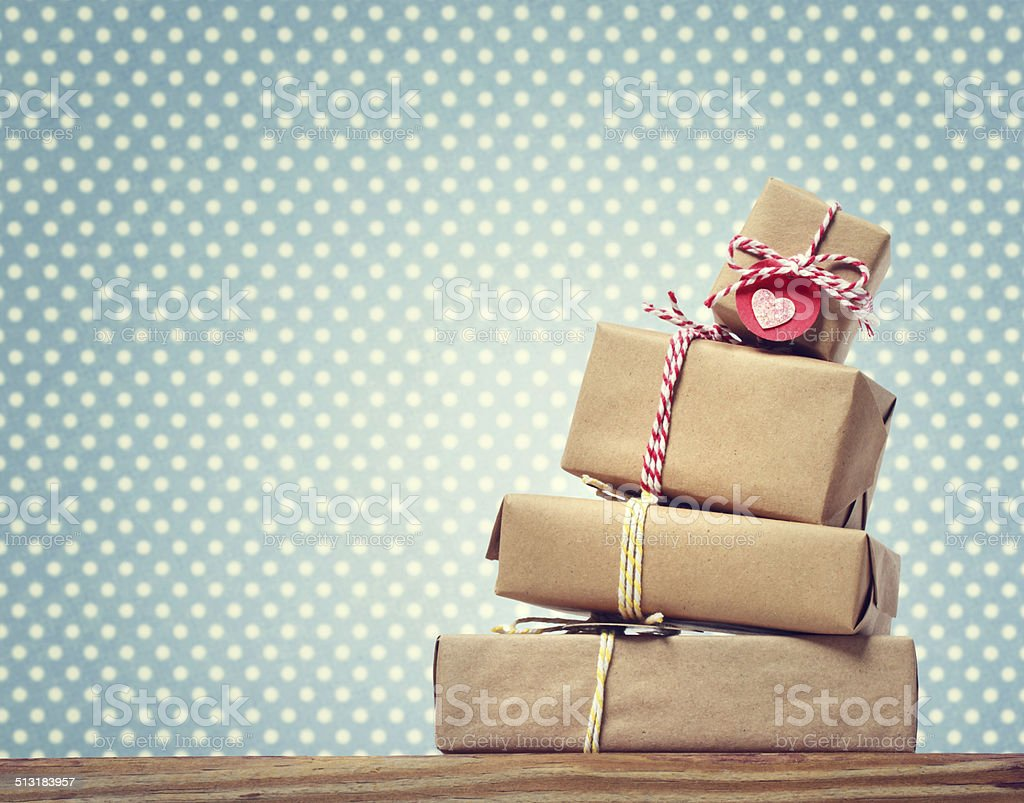 Handmade gift boxes over polka dots background stock photo