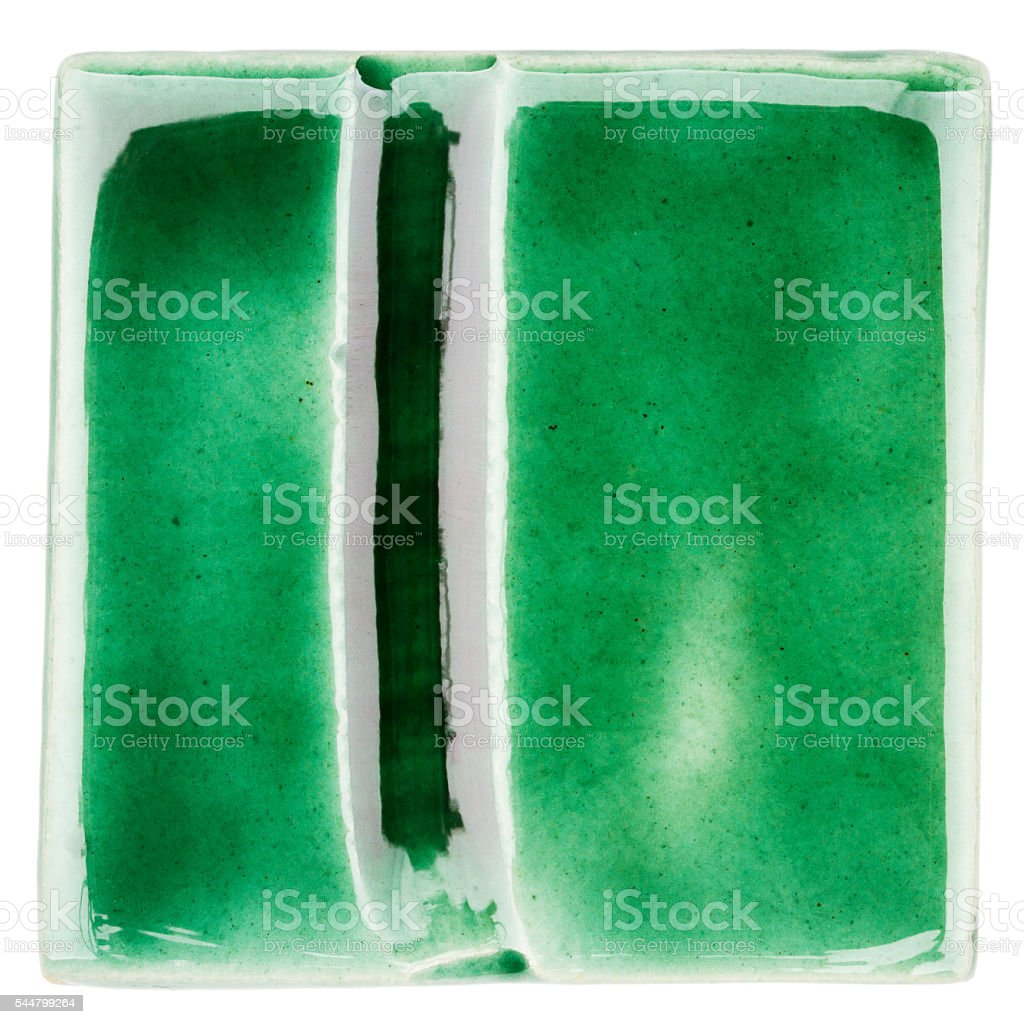 Handmade glazed ceramic tile stock photo