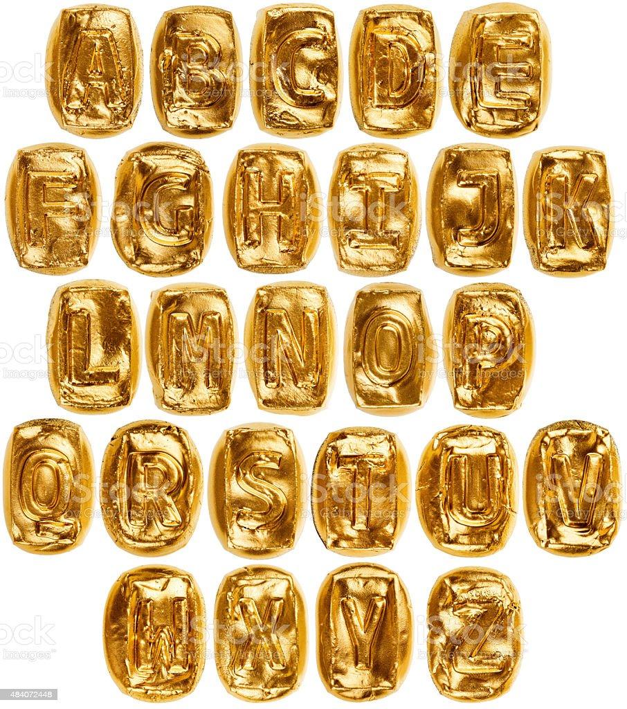 Handmade golden ceramic alphabet stock photo